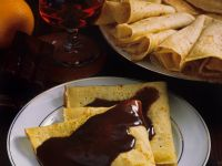 Walnut Filled Crepes with Chocolate-Rum Sauce recipe