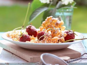 Batter-fried Elderflowers with Strawberries recipe