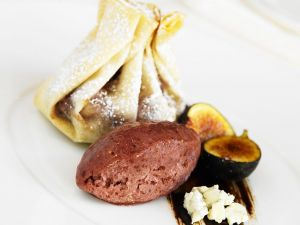 Chocolate Stuffed Crepe Purses with Raspberry Sorbet and Flambéed Figs recipe