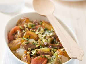 Lamb Tajine with Tomatoes, Apricots, Onions and Pistachios recipe