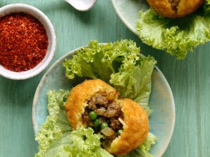 Saffron Arancini Stuffed with Meat and Peas recipe