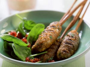 Spicy Lamb Skewers with Spinach and Pomegranate Salad recipe
