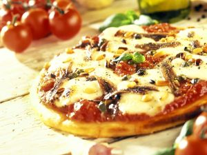 Tomato and Mozzarella Pizza with Anchovies and Pine Nuts recipe