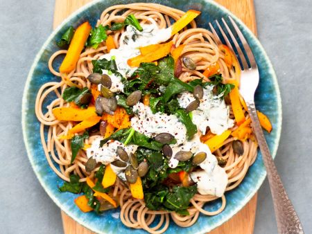 Spaghetti with pumpkin and spinach-goat cream cheese sauce
