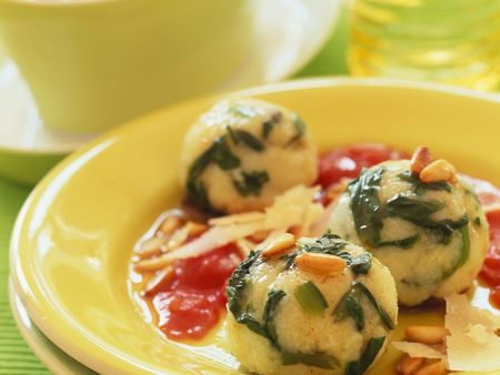Spinach Dumplings with Tomato Sauce and Pine Nuts