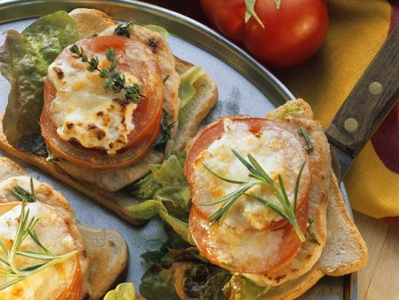 Toast with Pork Steaks, Tomatoes, and Cheese