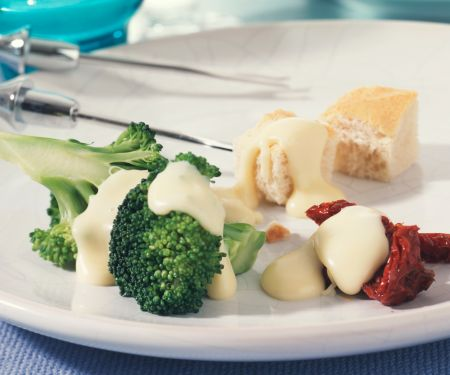 Cheese Fondue with Marinated Broccoli and Dried Tomatoes