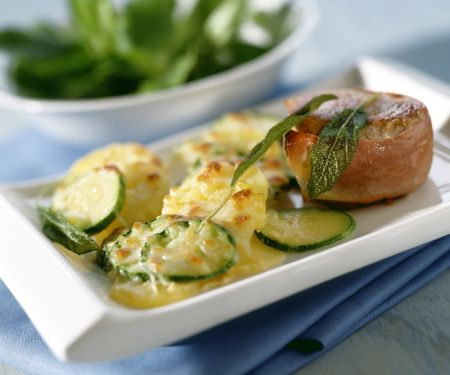 Potato and Zucchini Gratin with Pork Medallions