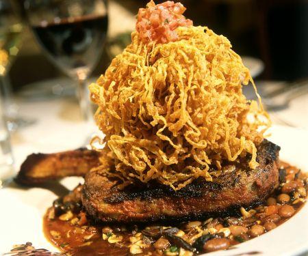 Rib Eye Steaks with Potato Straws and Lentils