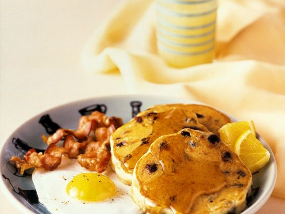 American Pancakes with Fried Egg, Bacon and Syrup