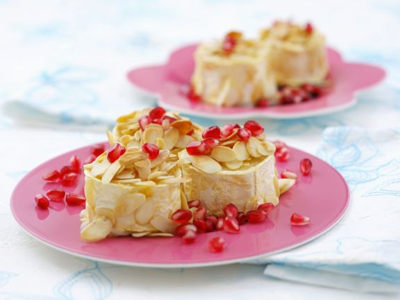 Baked Goat Cheese with Almonds and Pomegranate Seeds