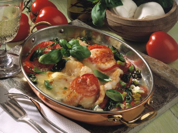 Baked redfish fillets with tomatoes and basil recipe eat for Red fish taste