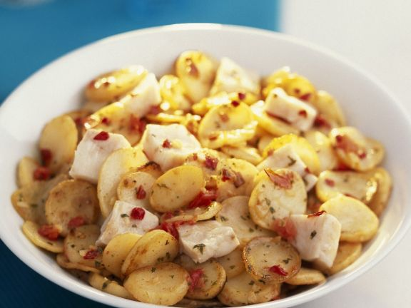 Bowl of Sliced Potatoes with White Fish
