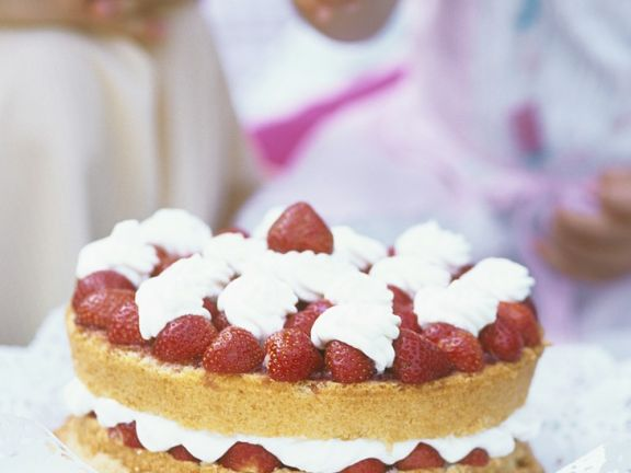 Cake with Fresh Strawberries and Whipped Cream