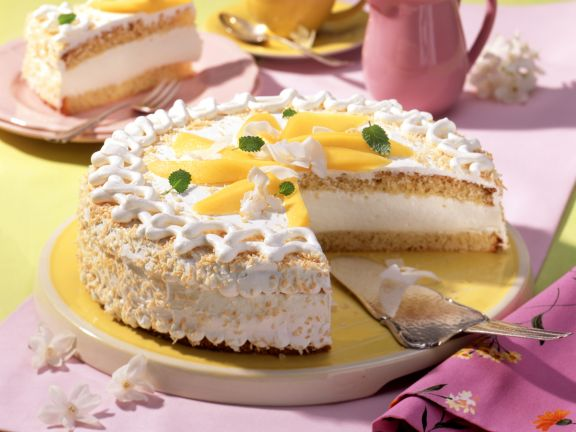 Coconut Cream Layer Cake with Sliced Mango