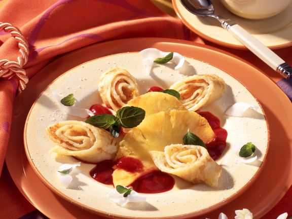 Coconut Crepe Rolls with Pineapple and Raspberry Puree