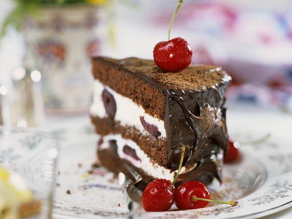 Cream and Chocolate Cake with Cherries