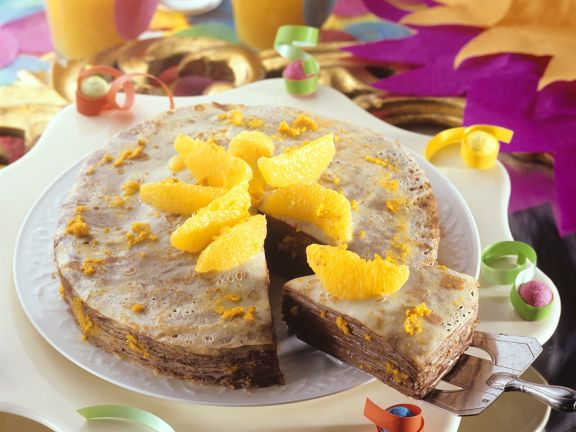 Crêpes Cake with Nut Nougat Cream and Oranges