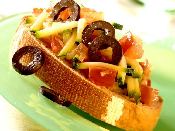 Crostini with Zucchini, Tomatoes and Olives