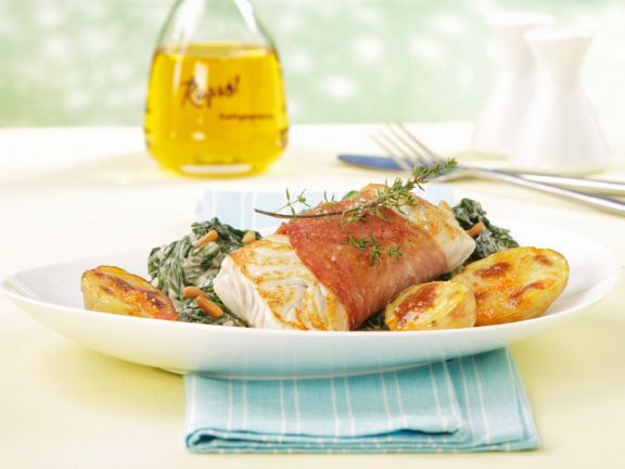 Fish Wrapped in Ham with Potatoes and Spinach