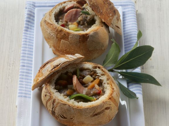 Lentils and Bacon Soup with Sausage in Bread Bowl