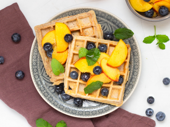 Oat and Spelt Waffles with Peach Berry Topping
