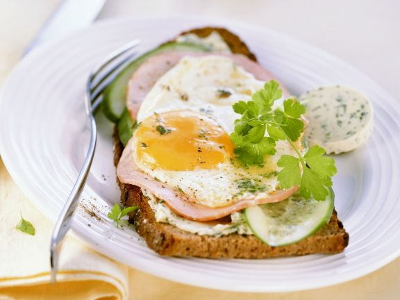 Open Sandwiches with Herb Butter, Ham, Cucumber and Fried Eggs