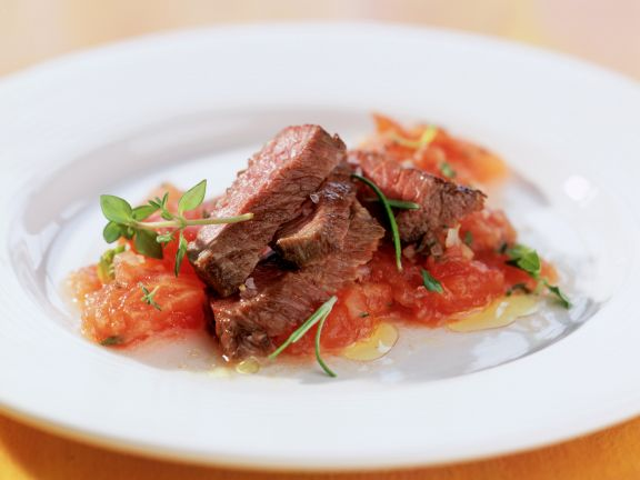 Ostrich Steak with Tomatoes