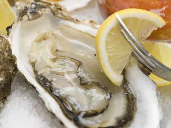 Oysters with Lemon and Cocktail Sauce