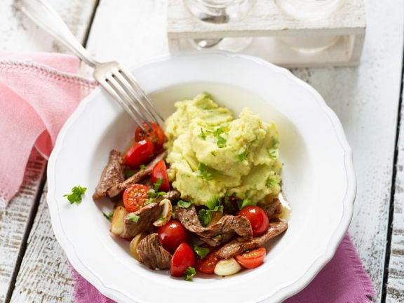 Pan Fried Steak Strips with Tomatoes and Onions Served With Potato and Avocado Puree