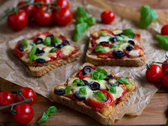 Pizza Toasts with Tomatoes, Olives and Mozzarella
