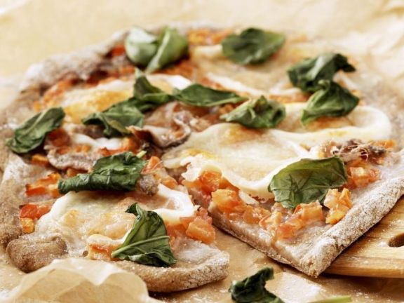 Pizza made healthier: spelt crust, fresh tomatoes and part-skim cheese