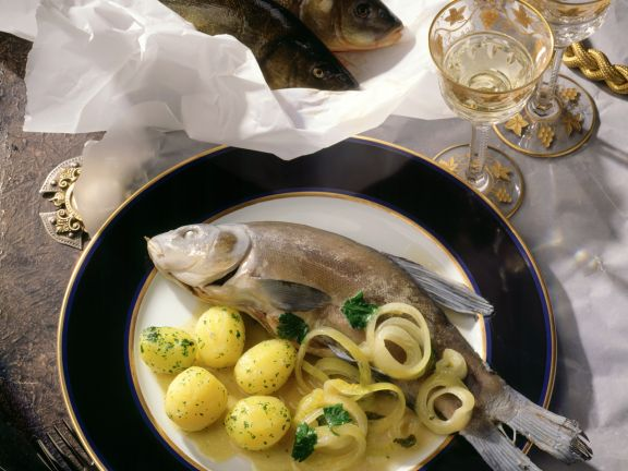 Poached Whole Fish with Onion Sauce