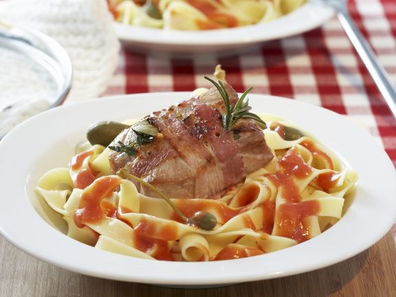 Pork Wrapped in Bacon on Tagliatelle with Tomato Sauce