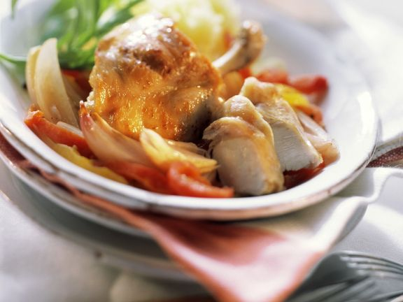 Rabbit with Peppers, Onions and Vermouth Sauce
