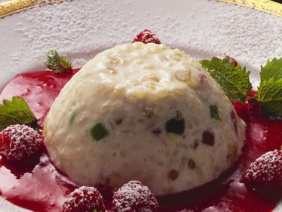 Rice Pudding with Candied Fruit and Raspberry Sauce