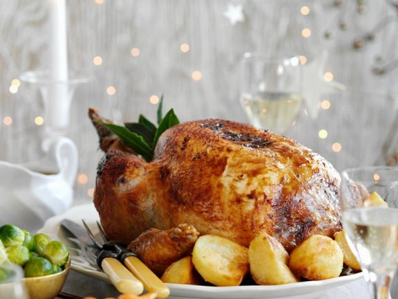 Roast Turkey with Stuffing, Potatoes and Glazed Carrots