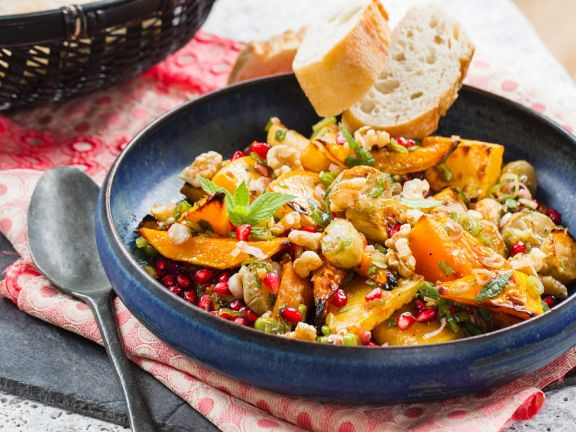Root vegetables and pumpkin with pomegranate seeds and orange