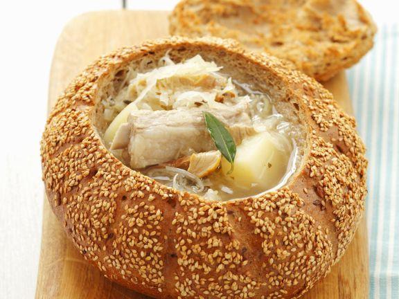 Sauerkraut Soup with Pork Ribs in a Bread Bowl