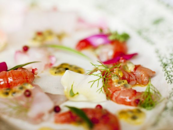 Sea Bass Carpaccio with Prawns and Passionfruit Rosewater Dressing