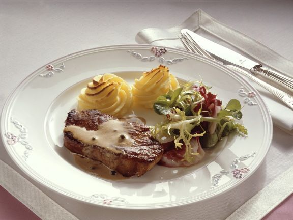 Seared Steak with Green Peppercorn Sauce and Duchesse Potatoes
