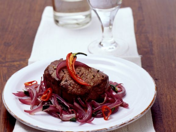 Sirloin Steaks with Chile Peppers and Onions