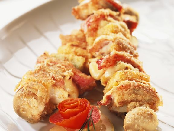 Skewers with Cheese, Bacon, Peppers, Onions and Mushrooms in Breadcrumbs