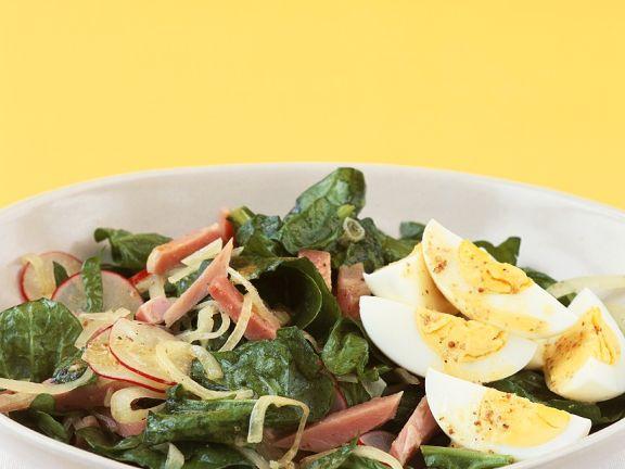 Sliced Egg with Salad Leaves