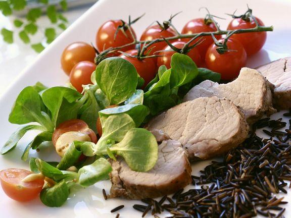 Sliced Pork Tenderloin with Rice and Salad