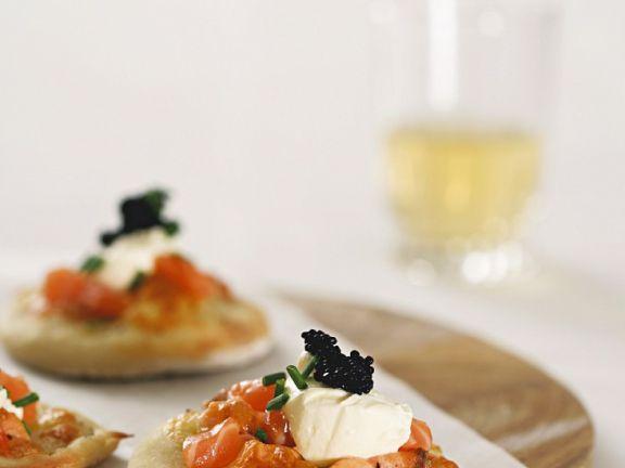Small Pizzas with Caviar, Salmon and Mozzarella