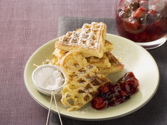 Spaghetti Waffles with Powdered Sugar and Berry Compote