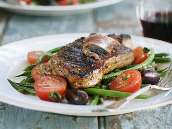 Steak with Anchovies, Green Beans, Olives and Tomatoes