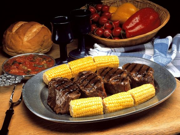 Steak with Corn on the Cob and Tomato Sauce