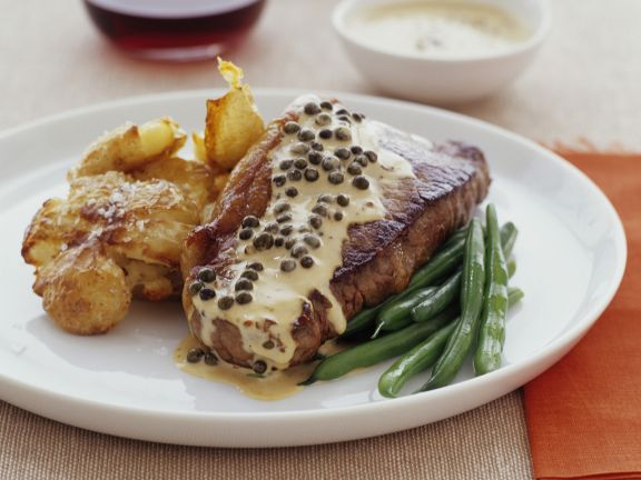 Steak with Peppercorn Sauce, Potatoes and Beans
